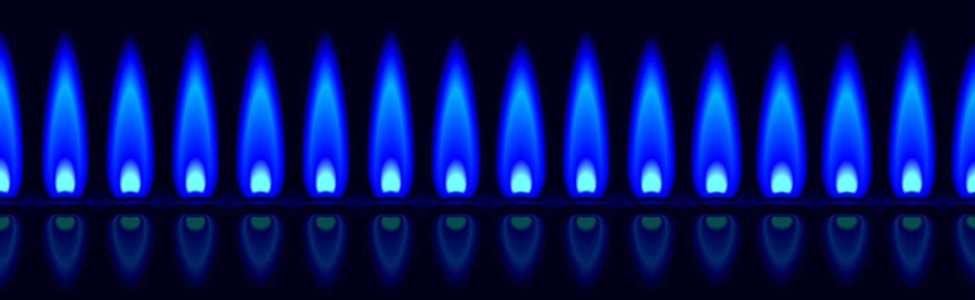 Blue Gas Flame From A Gas Fireplace Burner Installed By Portland Gas Piping, Explore Our Gas Piping Frequently Asked Questions
